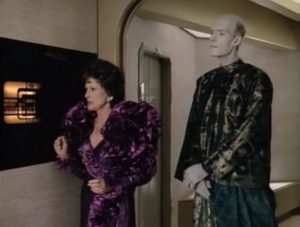 Lwaxana talks to the computer, which means she talks to herself. What an absurd outfit. I guess that's what they were going for