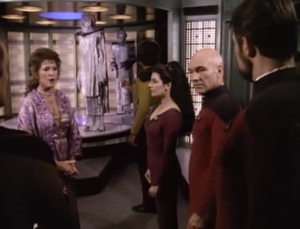 At the end Lwaxana can sense that the fish people are hiding bombs, and are really terrorists. I kind of like that not a lot happens in this episode