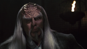 Kolos talks about how his parents were a biologist and teacher, and the warrior class of Klingons have taken over society. He talks about how honor used to mean courage, fighting greater opponents, and standing up for integrity