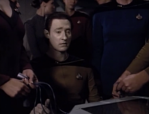 Data loses and starts to think he's damaged