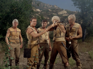So Kirk teaches the blond-haired group to use guns