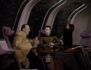 In the middle of a standoff with the Ferengi ship, they call a meeting