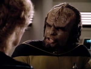 Worf has the Klingon measles and he's embarrassed. Pulaski makes up a story to cover for him