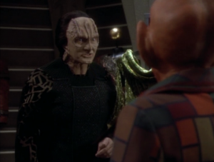 Garak and Quark talk about the consequences of bad fashion trends. For the benefit of the Voyager fans, they're actually talking about political trends
