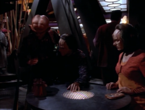 Quark starts hitting things to check if Odo is spying on them