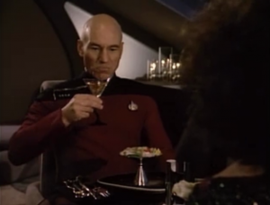 She tricks Picard into having dinner with her