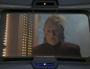 The Talaxian ship was attacked by the Kazon. The Kazon messed up this guy's hair! and they also took Tom Paris