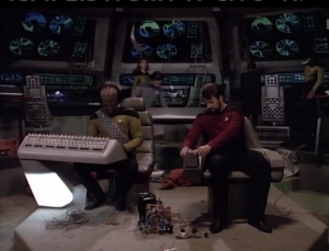 Riker has to face Picard in a war game. He assembles his team and starts to prepare.