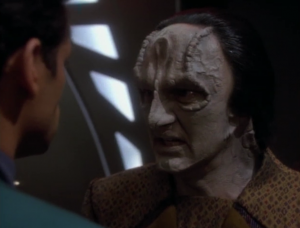 Garak explains that what really happened was that he was punished for allowing the Bajorans to get away. He talks about a man named Tain a lot. He was the head of the Obsidian Order and Garak was his right hand man