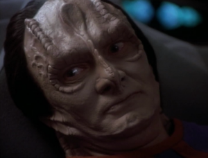 Garak is dying! He said he was best friends with Elim, but something went wrong and he tried to pin it on Elim, but Elim had beat him to it. Garak ended up taking the fall, and being exiled
