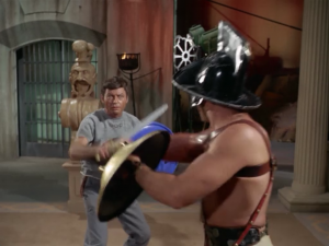 Bones and Spock have to fight to the death on TV. By this time I've moved on and accepted that this is a duplicate of earth where Rome never fell, but why do they still dress like ancient Romans on TV?