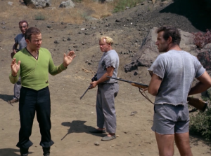 Kirk, Bones, and Spock beam down but they're captured by a man in shorts