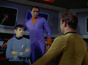 """Kirk wants to go down to a planet with Bones and a geologist. The M-5 recommends sending different people because Kirk is """"non-essential personnel"""". Doesn't the computer know that Kirk is the main character and gets to go everywhere?"""
