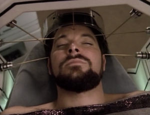 The camera man gets a lot of practice zooming in on Riker's face