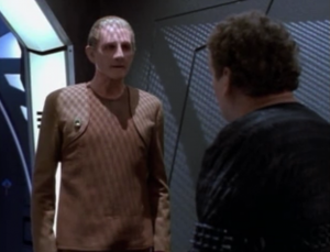 Odo comes to help O'Brien during the trial