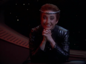 She talks about how Kirk influenced Mirror-Spock to reform humanity...and it led to them being overrun by an alliance by the Klingons and Cardassians. That's depressing.