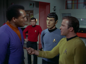 Kirk jabs Dr. Daystrom with his finger