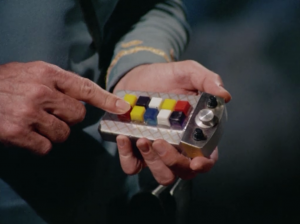 The controls on this remote could've been more clearly labeled. The button he's pushing now is apparently the button to make Spock rotate to his left.