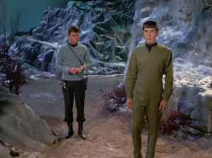 Bones beams down with Spock, who is being remotely controlled