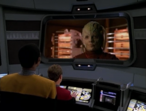 The vidiians seem nice and they get Voyager in touch with The Doctor's lady friend. The vidiians agree to give them the cure, but Tuvok wants to run a bunch of drills just in case
