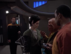 When they get back to the station Quark discovers that the necklace has no device to subdue magic powers. It was just a lock. The lady was meant to be a spy!