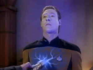 Data has a meeting with some colonists but that leader jerk wasn't invited. He comes anyway and electrocutes Data