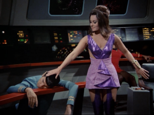 A space lady comes on board, knocks everyone out, and touches Spock's head. She probably wants his brain!