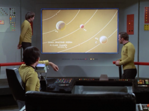 Kirk traces the space lady to the Draconis system. He has to choose between three planets she could be on, but none of them are developed enough to have her technology