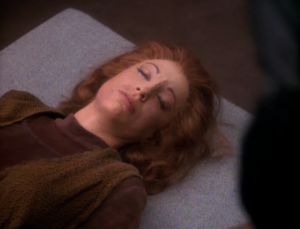 They show Kira the dead body of the person she replaced