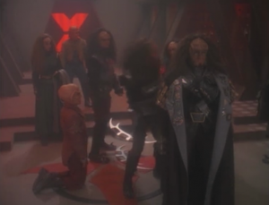 Quark gives up and the brother was going to kill a defenseless ferengi. That isn't very honorable, so Gowron kicks the brother out
