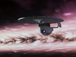 The ship is hit by a shock wave caused by Praxis exploding! It's Star Trek VI!