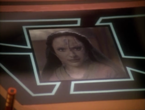 They also show her a transmission she recorded before she was surgically changed into Kira