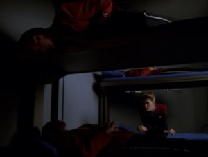 Starfleet officers sleep without blankets or jammies. They just lay there in full uniform