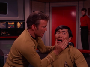 Kirk tries to get them to snap out of it