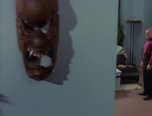 Picard comes to talk with the boy. Seriously look at this art on their wall. That would freak me out as a kid
