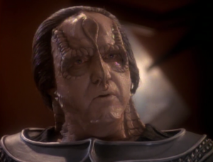 They're going to torture Kira to get the information from her and her father tries to get her out of there. Turns out he's a dissident and this whole plan capitalized on the coincidence that this guy's daughter looks exactly like Kira, and that she was surgically altered do recon as a Bajoran. The whole plan was to expose this guy as a dissident. But why would this expose him as a dissident? What if he was just a father that didn't want his daughter tortured?