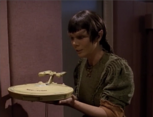 Picard shows the leader some more cool stuff. Isn't Troi about to be killed or something? Picard knows she's in danger