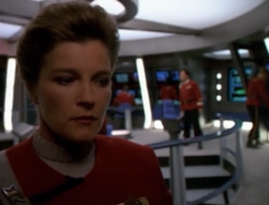 Tuvok's mind starts to go, and now people can see Janeway. She steals Rand's uniform