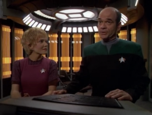The Doctor explains that it was a virus that disguised itself as a repressed memory and transferred to Tuvok when his friend died
