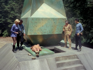 "They figure out that the Obelisk is operated by sound, specifically saying ""Kirk to Enterprise"". The obelisk deflects the asteroid"