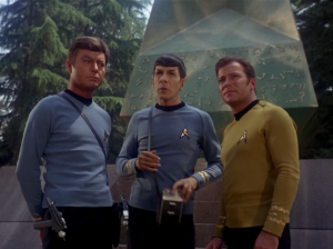 Spock explains that they only have 30 minutes to look around before they need to go deflect the asteroid heading towards this planet. Wait, why are they wasting time looking around here in the first place?