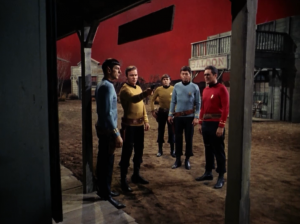 Kirk and company have to act out the OK Corral shootout as the Clanton gang. This seems like the most reasonable way an alien can teach Kirk a lesson