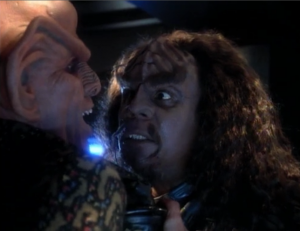 The Klingon's brother visits Quark and wants to know if his brother died with honor