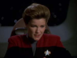 Janeway decides that they need to stop the Ferengi from interfering with this planet
