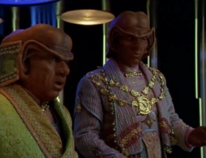 They beam the Ferengi aboard and the Ferengi convince Janeway that if they're removed it would cause the society to become sad, or go into chaos or something.