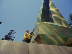 Kirk goes back to check out the obelisk and falls into a secret chamber!
