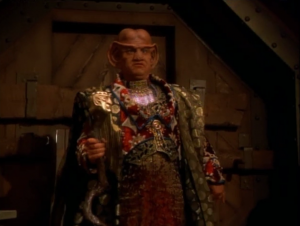 So instead, Janeway sends Neelix down dressed as a Ferengi. He says the Grand Negus wants them to leave