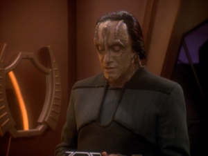 A guy explains to her that she's really a Cardassian agent for the Obsidian Order. She's been made to look like a Bajoran to learn information.