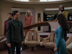 In the end Troi calls him out, and then he buys a worthless wormhole