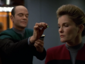 The spirits tell Janeway she has what she needs to save Kes. The Doctor interprets this to mean the venom from the bite must help Kes